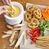 Beer & Cheese Fondue  Dip in! Thick and satisfying beer-and-cheese fondue (which, as the name suggests, calls for two kinds of cheese and two cups of beer), adds a hearty start to your affair. Mix ahead and then warm up this appetizer in a slow cooker at dinner time.
