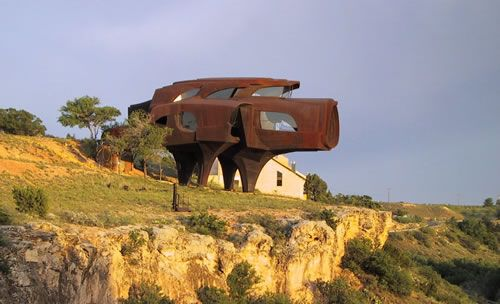 steel house by Robert Bruno, Texas; it took 23 years to complete this modern shaped house out of 110 tons of steel.