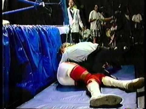 Jim Neidhart (in KKK outfit) attacks Virgil