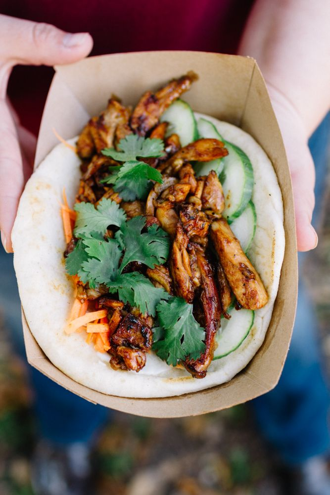 Chicken thighs, hoisin sauce, carrots, and cucumber appear in this delicious variation of a Korean barbecue taco, Rue Chow's Korean BBQ Chicken Pita - Behind the Food Carts