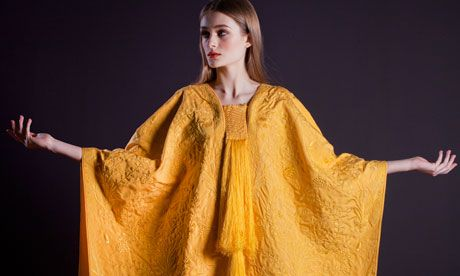 Simon Peers and Nicholas Godley, a textile artist and a designer-entrepreneur respectively, have created a shimmering golden cape from spider silk, a fabric not woven in more than a century. The silk was extracted in Godley's workshops and woven by Peers' team of handloom weavers in Madagascar. This is the natural color of the silk.