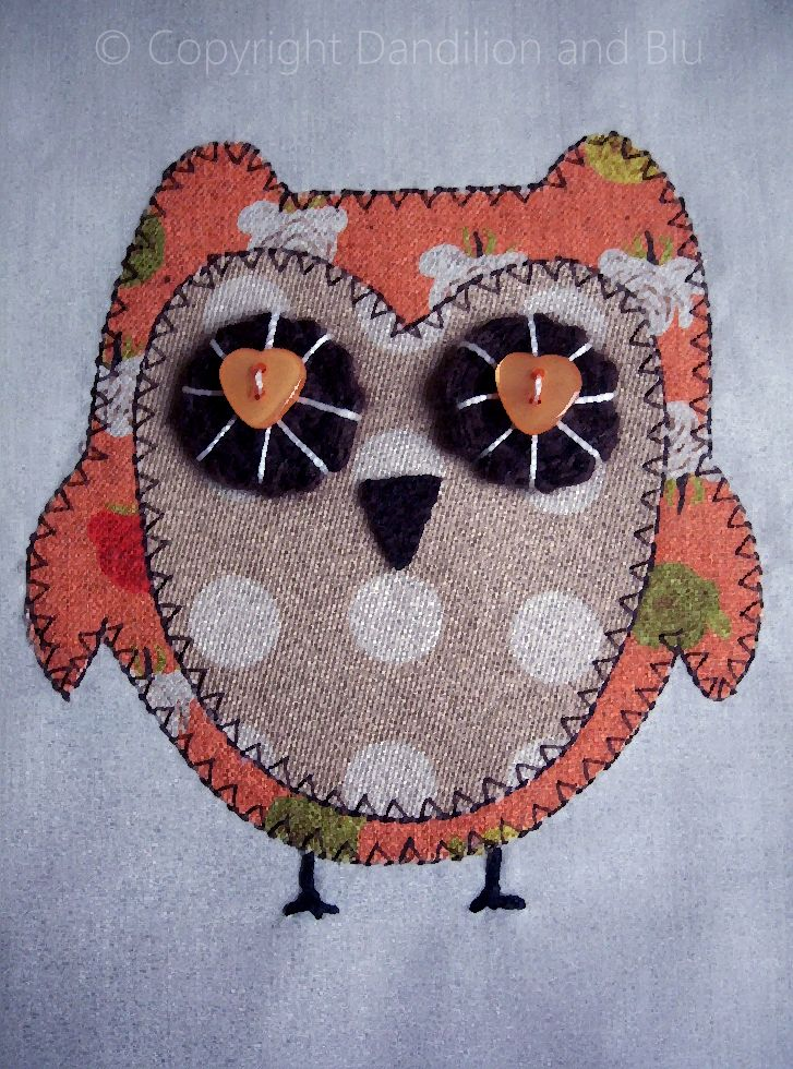 Dandilion and Blu applique owl with crocheted and button eyes.
