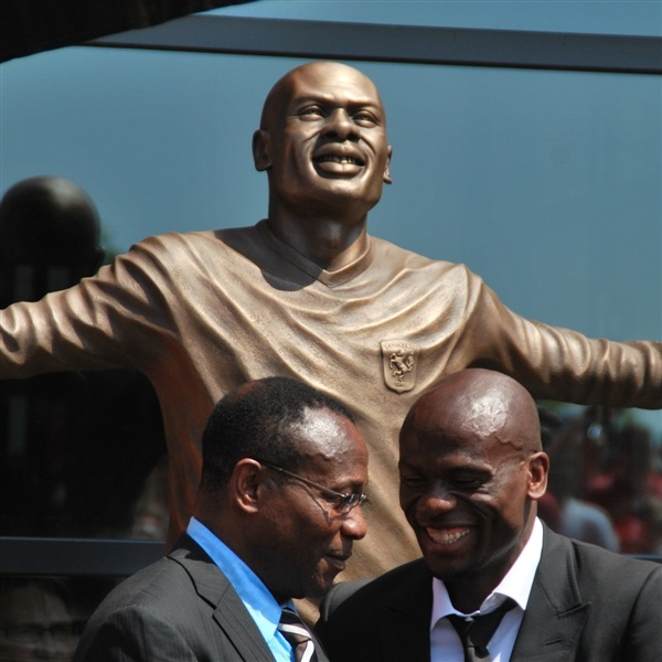 Special moment: former FC Twente striker Blaise N'Kufo reveals his own statue with his father