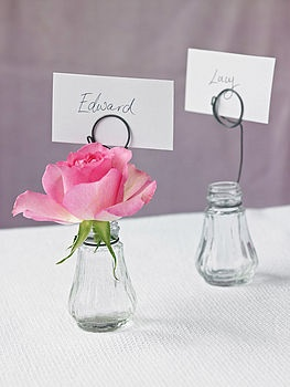 Name place holders for tables made with wire and salt and pepper shakers