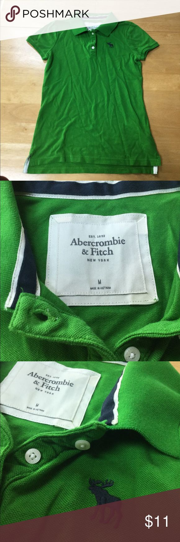 Abercrombie & Fitch, Polo Shirt Description: green polo shirt w/ navy A&F logo, lightly used, 96% cotton, 4% elastane Abercrombie & Fitch Tops Blouses