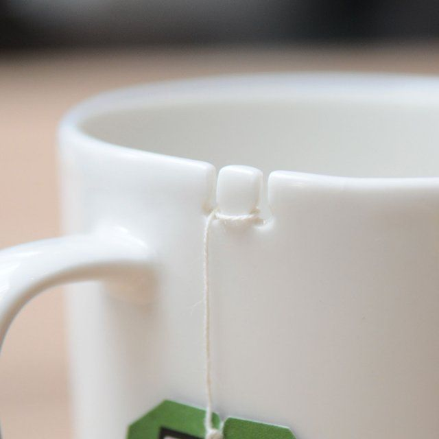 Tie Tea Mug From Le Mouton Noir  / The brilliant Tie Tea Mug designed by George Lee's le mouton noir & co is designed to tackle one of life's ugly realities – the lost tea bag floating around somewhere in a piping hot cup of tea. http://thegadgetflow.com/portfolio/tie-tea-mug-le-mouton-noir-co/