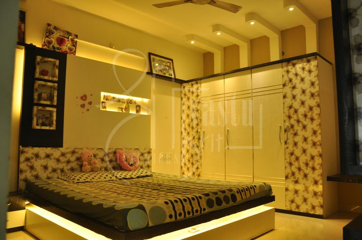 A warm cozy room that displays the beautiful relationship of a couple residing.  Designed by #ShriVastuKrit #InteriorDesigner #Bedroom #VastuConsultant #Indore
