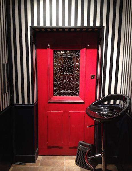 A Parisian bar hidden behind the 'Little Red Door'.