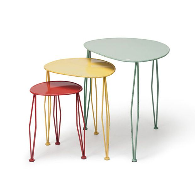 From their bowed legs up to their oblong tops, these nesting tables radiate fun, funky style. Unexpected candy colors make them a playful choice for jazzing up the living room.