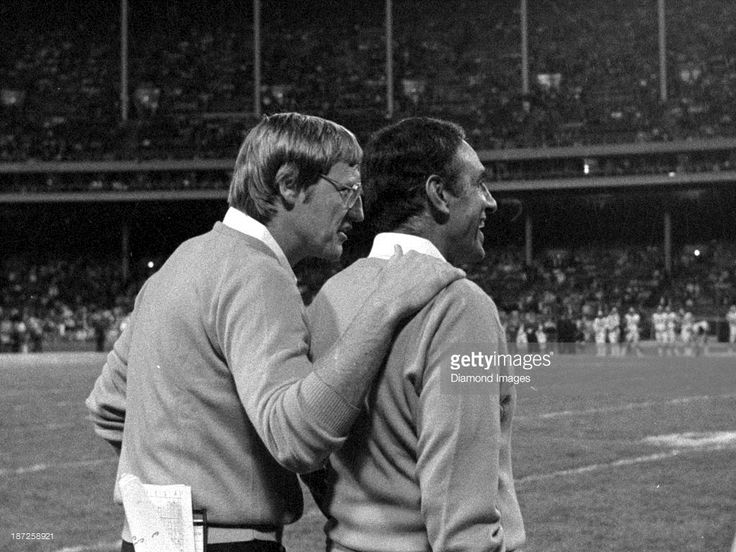 Head coach Sam Rutigliano of the Cleveland Browns is congratulated by defensive coordinator <a gi-track='captionPersonalityLinkClicked' href=/galleries/search?phrase=Marty+Schottenheimer&family=editorial&specificpeople=184515 ng-click='$event.stopPropagation()'>Marty Schottenheimer</a> on the sideline during a game against the Cincinnati Bengals on September 15, 1983 at the Cleveland Municipal Stadium in Cleveland, Ohio. Cleveland won 17-7.