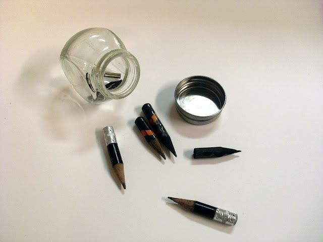 Small pencil stumps in a small glass jar.