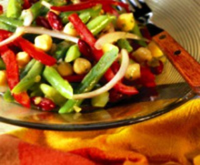 Italian three bean salad is made with kidney beans, garbanzo beans and green beans. Vegetarian bean salad is a high-fiber and high-protein vegetarian bean salad perfect for a picnic or potluck. You'll want to prepare it the night before to let the beans marinate in the dressing overnight. This recipe is vegan as well as vegetarian.