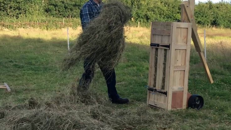 Making handmade hay bales with a box baler Hay bales