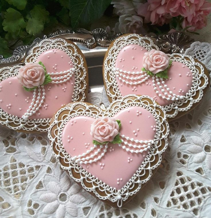 Pink heart cookies with pink rose and strands of pearls. Cookies by Teri Pringle Wood