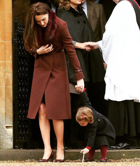 Princess Charlotte was in a playful spirit as she tried to place her candy cane in the ground.