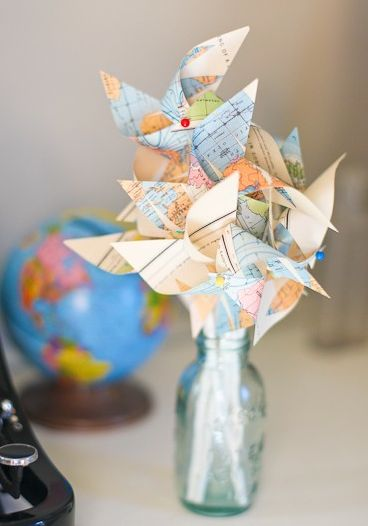 map pinwheels- centerpiece? The idea of travel themed wedding is growing on me..  :)