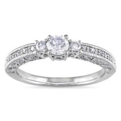 Round-cut white diamond engagement ring14-karat white gold jewelry  love how simple it is but still so pretty!