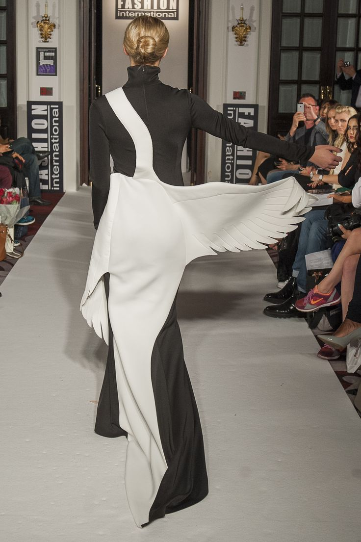 "Lenie Boya ""Dramatique"" Collection at London Fashion Week S/S 2016 Haute Couture. Black and white Salvador Dali And Surrealism inspired 3D Sculptured swan dress."