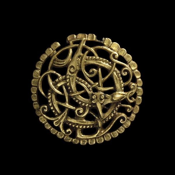 The Pitney Brooch  This elegant openwork brooch was found in a churchyard. The skill needed to make it indicates that it was probably worn by a man or woman of some importance, and the brooch would have been considered a symbol of prestige.