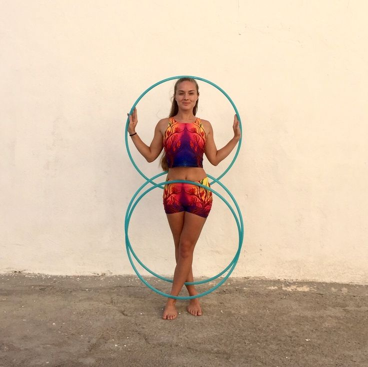 """Sky wearing Lovescapes """"Magica"""" shorts and crop top and doing her magic with hoops from Hoopologie"""