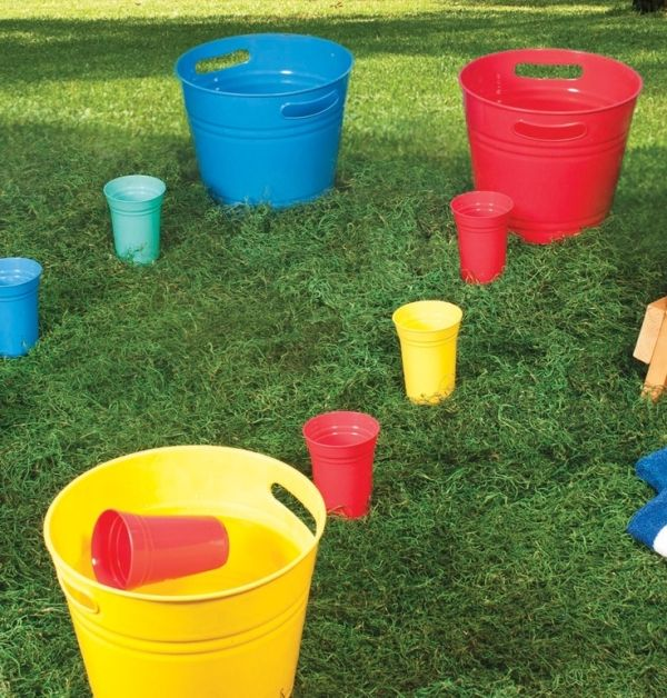 Have a relay race by carrying cups of water to fill up buckets