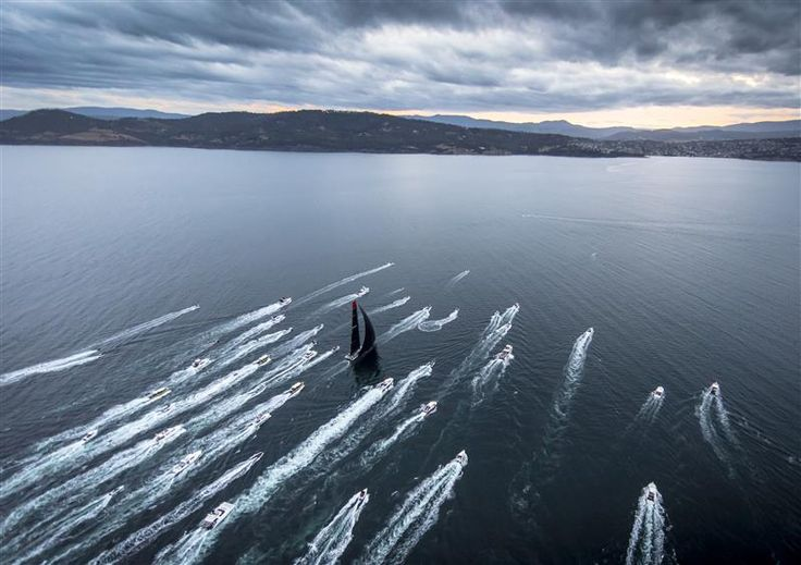 SPECTATOR BOATS ESCORTING COMANCHE (USA) TOWARDS THE FINISH LINE IN HOBART Photo: Rolex / Kurt Arrigo