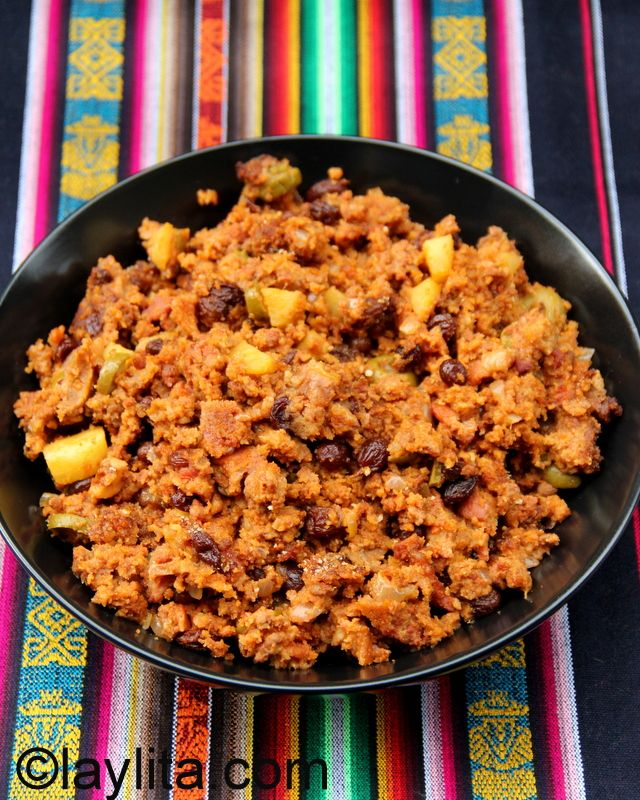 Relleno de Pavo Navideño or Christmas turkey stuffing - (But why wait...) A sweet and savory holiday turkey stuffing made with ground meat, chorizo, bacon, apple, raisins, olives, walnuts, bread crumbs, spices, herbs and more.