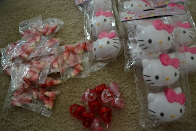 """I did a game I called """"Find the Kitty"""" where I stuffed these Hello Kitty """"eggs"""" with candy and lip gloss rings. I hid the cats and then each girl ran around looking for one.  The girl whose cat also had a sticker won a Hello Kitty necklace/bracelet set.  It was a big hit."""