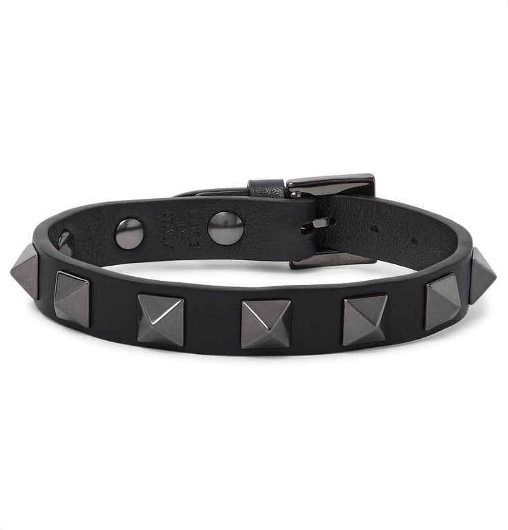 You don't have to be a heavy metal fan to appreciate the appeal of a studded leather bracelet. Made in Italy, this refined navy version by <a href='http://www.mrporter.com/mens/Designers/Valentino'>Valentino</a> is punctuated with signature gunmetal pyramids and has a secure buckle fastening. Wear yours with casual looks or let it peek out beneath the cuff of a shirt if your office dress code allows.
