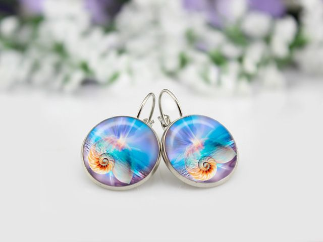Stop by now and check out my new Aqua Escape Cabochon Collection, handmade using altered artwork sourced from suppliers around the world. Available with matching necklace in your choice of Silver or Antique Bronze.