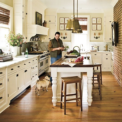 Loves the island and exposed brick