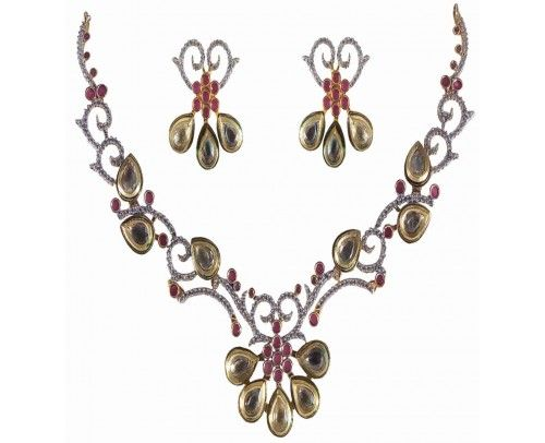 A Charming American Diamond Necklace Set Designed Perfectly from the house of Rejewel.Necklace Set in Red colour CZ Stone studded throughout the piece makes you standout in the crowd.Dress up with these to Impress no one but You.