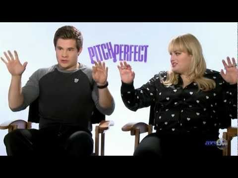 """The cast of """"Pitch Perfect"""" talks first-time singers, sexual tension, and five-fingered rings on AXSLive."""