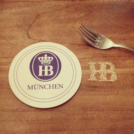 Drawing HB's logotype using the excess salt from the German pretzels
