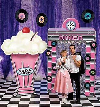 Use our 1950s diner decorations like our diner arch, milkshake standee and poodle scarf to create a fun event.