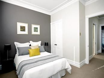 White walls with dark grey feature wall for the hall for Feature wallpaper bedroom ideas