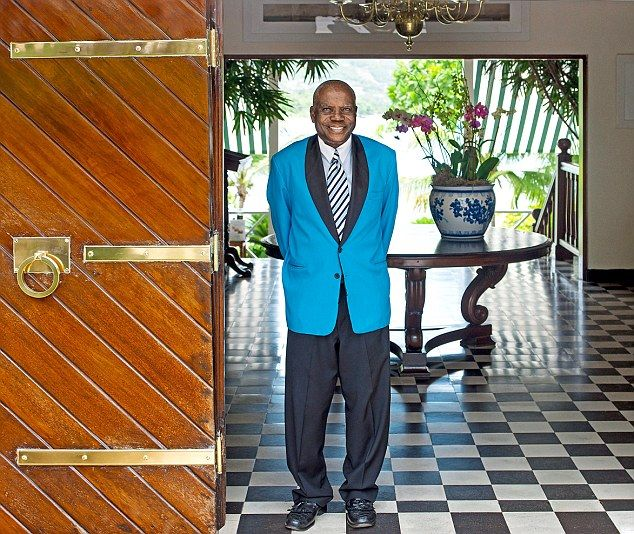 Service with a smile: The concierge at Round Hill, which has seen illustrious visitors includingJohn F. Kennedy
