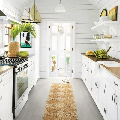 Homeowner Trish Becker installed smaller than standard appliances to conserve countertop space in this cottage kitchen. | Coastalliving.com