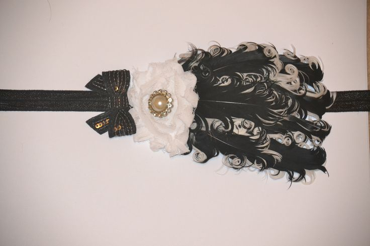 Love this black and white feather headband!