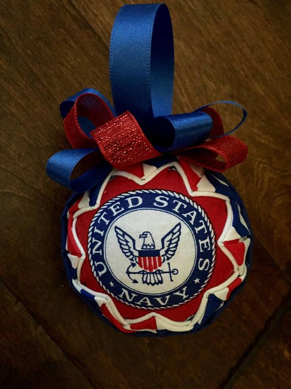 What a great way to honor those that serve/served in the United States Navy. The fabric ornament has been created with the Navy seal on each side. It has been accented with coordinating fabrics folded and pinned in layers around a 3 styrofoam ball. Lightweight. I have other military