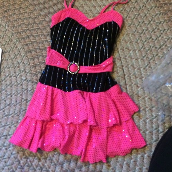 Shopaholic pin-stripe dance costume Pink sequin sparkle. Flouncy double layer skirt (briefs attached underneath) attached belt. Includes matching hair bow. Stretchy material. Weissman's Other