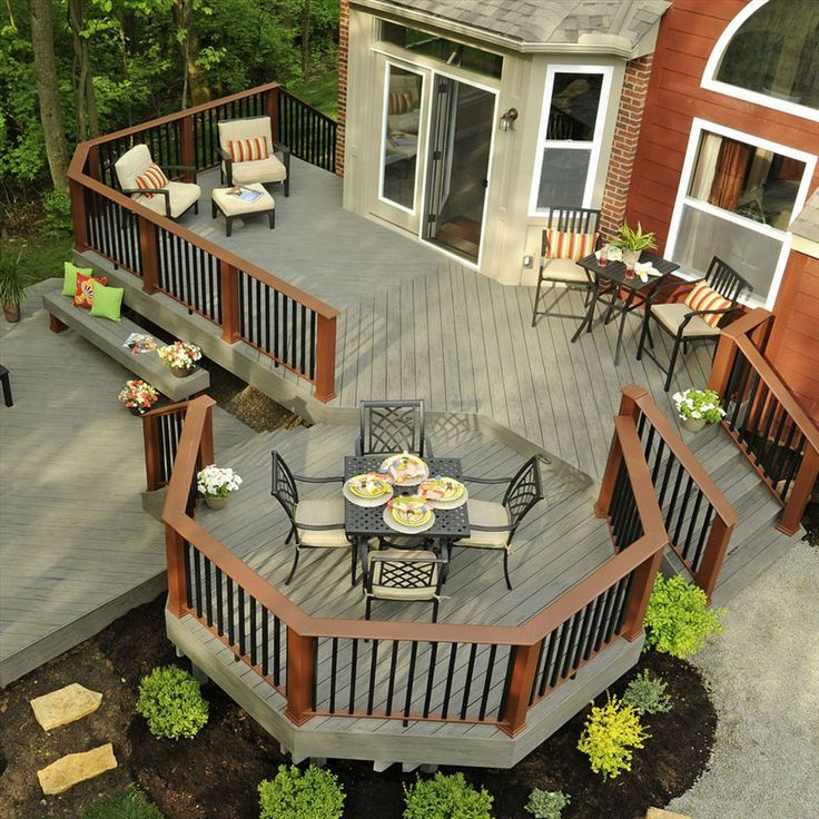 Composite dream deck with multiple levels. brown raised