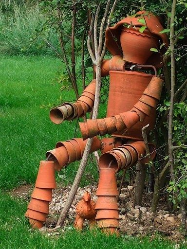 Pottery man made from old clay pots