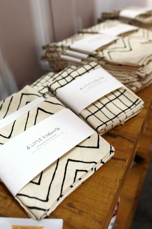 screen printed napkins with a paper sleeve with a message on?