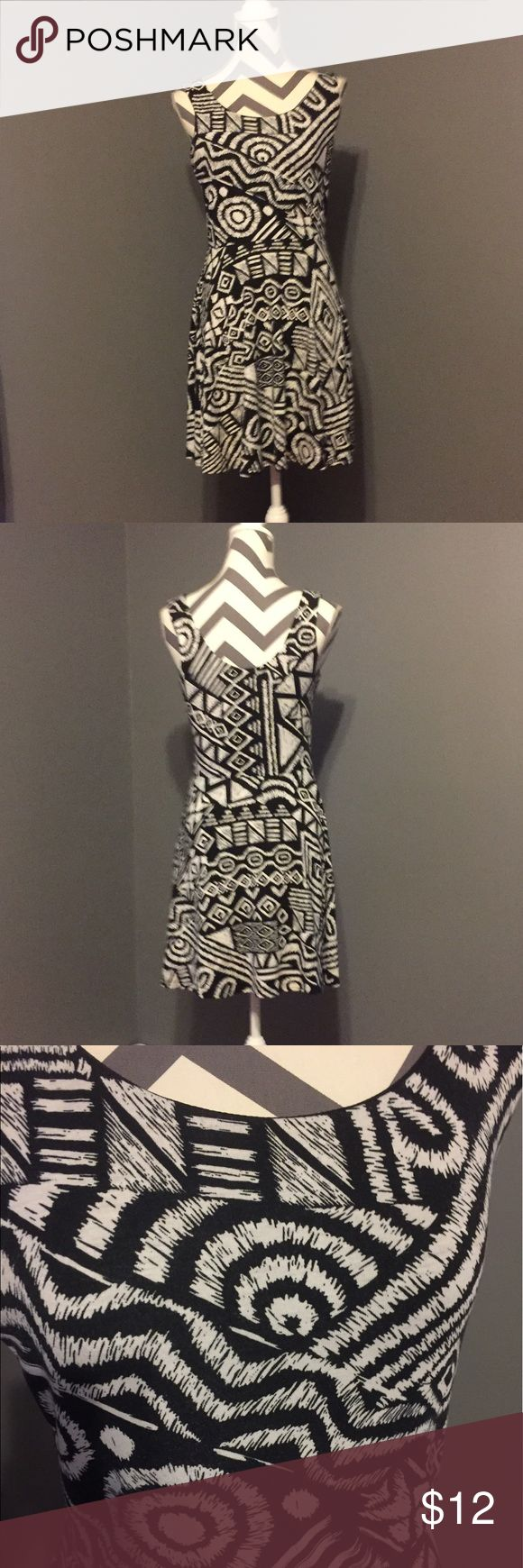 Geometric black & white dress Slight fit & flair. Fun sleeveless dress, can be dressed up or down. I usually put on a chunk black belt at the waist or a bit higher. From Nordstrom Rack. 95% polyester, 5% spandex gives it a fitted and stretchy feel. love...ady Dresses Mini