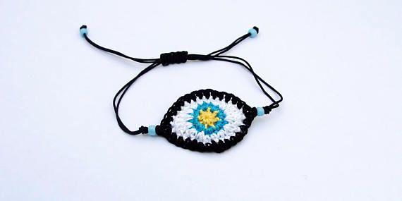 Crocheted Evil eye bracelet for good energy and good luck as the Greeks believe. The bracelet is handmade with high quality cotton thread and adjustable macrame closure to fit all sizes.