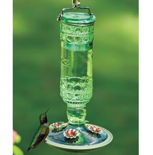 Antique Bottle Hummingbird Feeder.