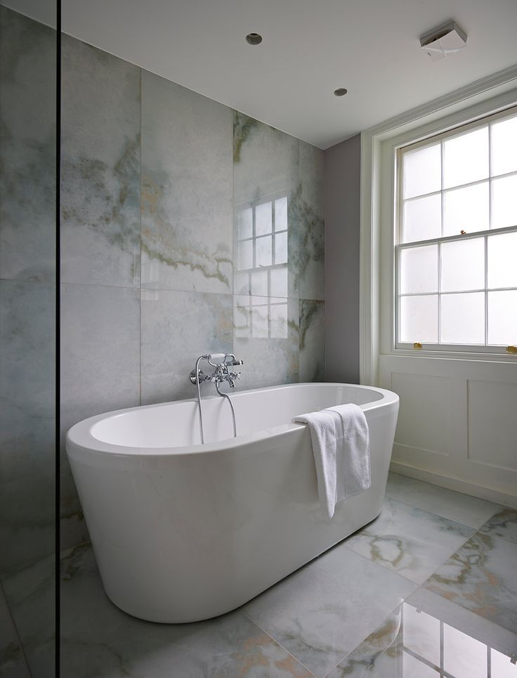 This elegant bathroom was designed by tania adir of g t for T g wall panelling in bathroom