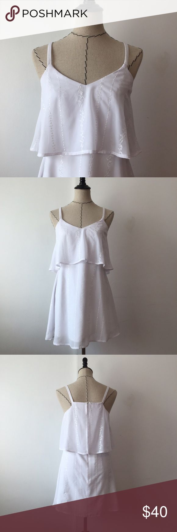 Love Sadie White embroidered dress Cute white embroidered dress! Size small. Zipper down the back. Has a slip underneath. Length is approx 23.5 from lowest and approx 25.5 from strap. Pit to pit is approx 16 Urban Outfitters Dresses Midi