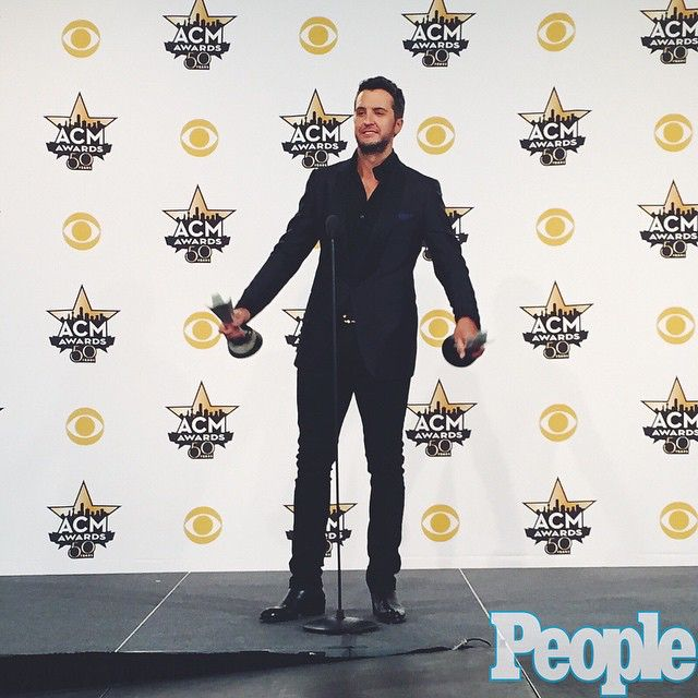 No, Entertainer of the Year Luke Bryan isn't doing a workout. He's just holding his two ACM awards. #ACMawards50